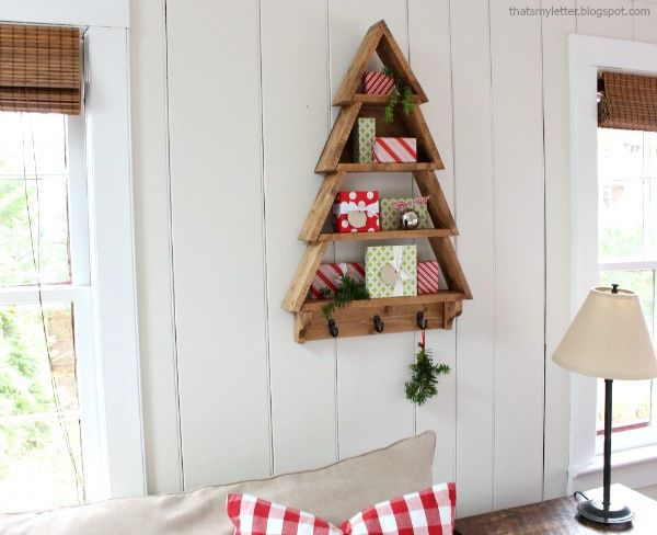 a diy tutorial to build a tree shelf perfect for holiday decor free plans from ana white make this an easy diy project for that special someone