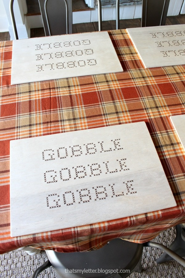gobble painted onto wood placemats