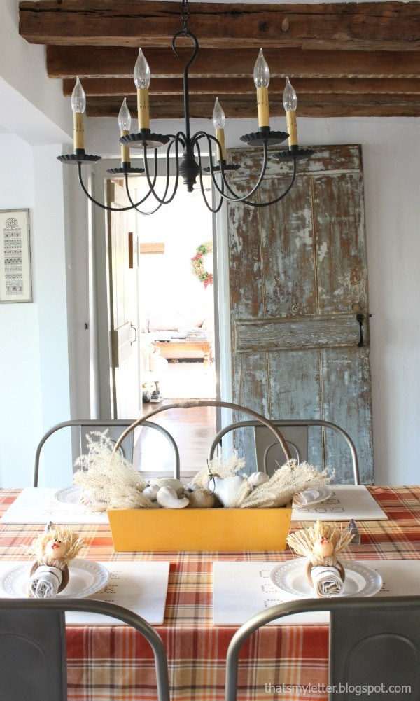 thanksgiving table in primitive farmhouse dining room