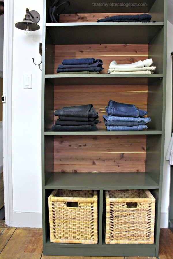 walk-in closet makeover with built-in shelves and baskets