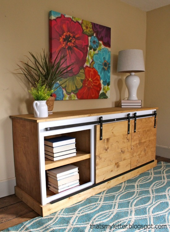 sliding barn door console in living room