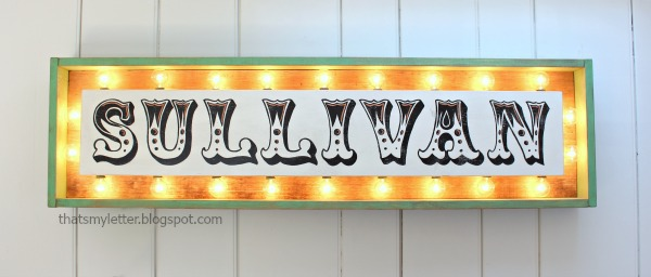 marquee sign with lights on