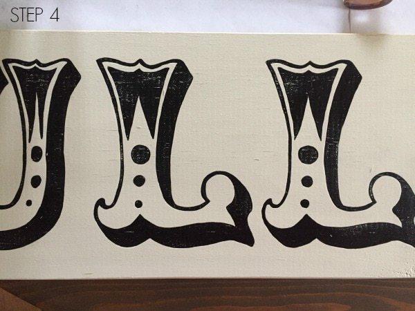 distressed handpainted letters on wood