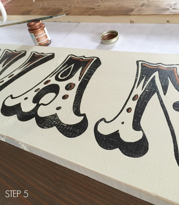 copper gilding details on handpainted sign