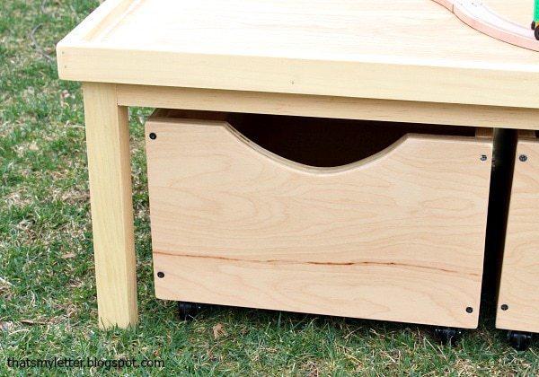storage bins under play table