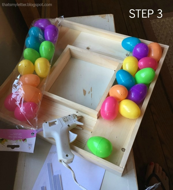 hot glue plastic eggs to wood base