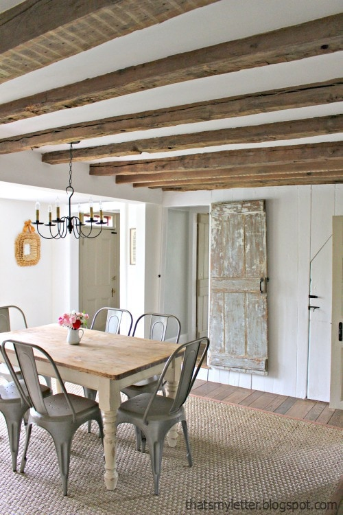 Exposed wood beams in dining bedroom ceiling
