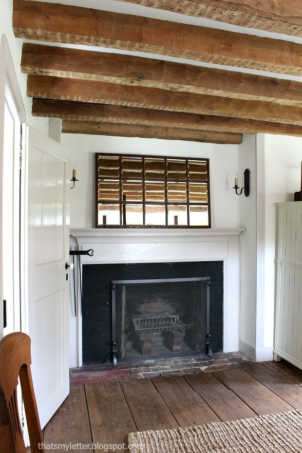 original wood beams above fireplace