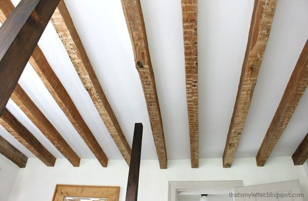 master bedroom ceiling with real wood beams