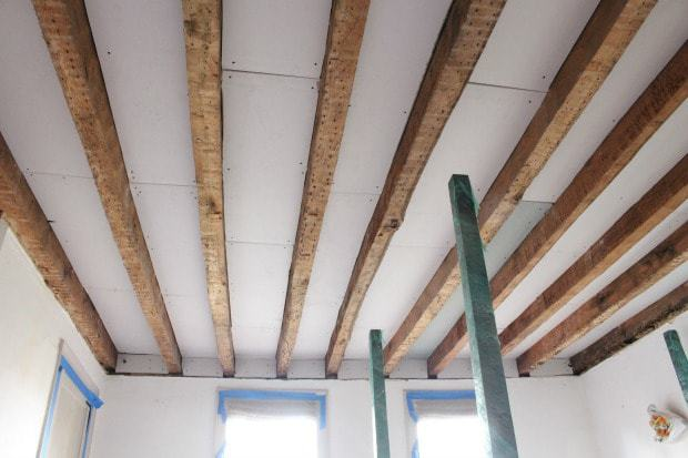 wood beams with sheetrock installed between