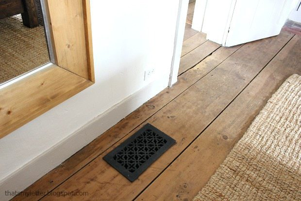 wide plank wood floors with cast iron hvac return cover