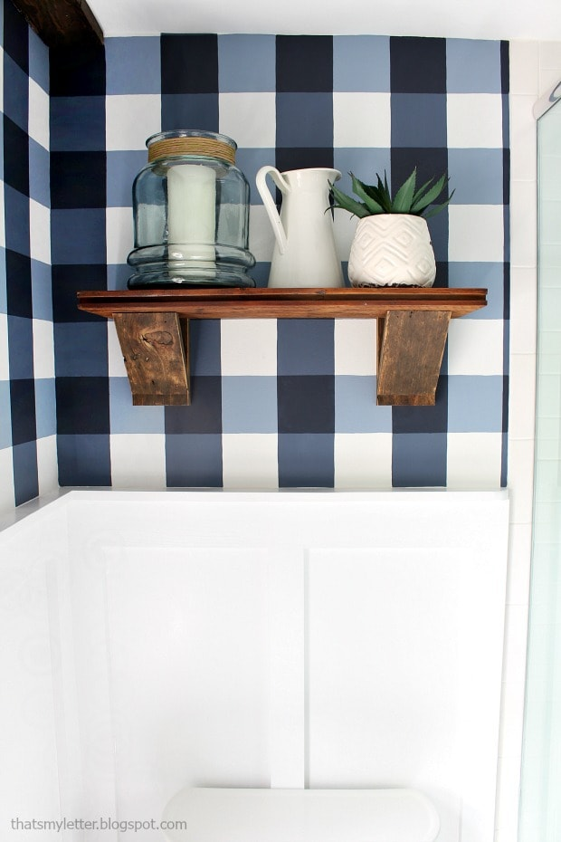 wood wall shelf above toilet