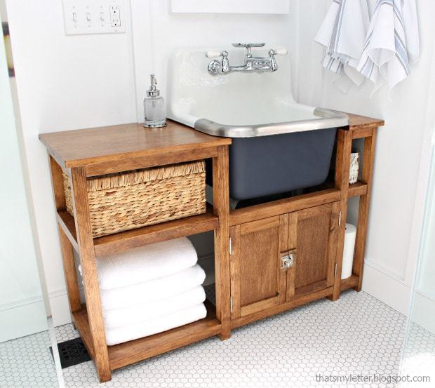 wall mounted sink with wood vanity