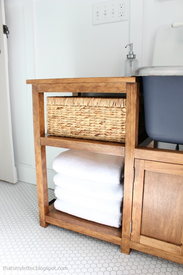 open shelf storage in master bathroom