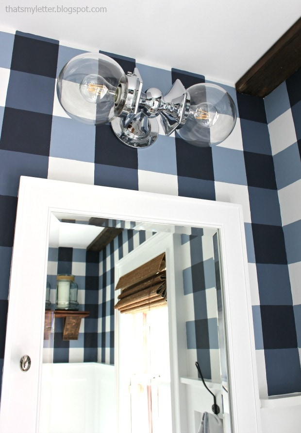 sconce and medicine cabinet in bathroom