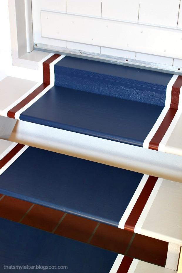 painted stripe runner on laundry room steps
