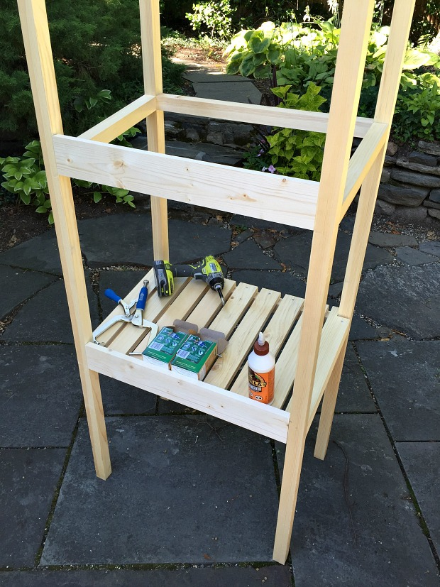 building a recycling tower with slanted shelves