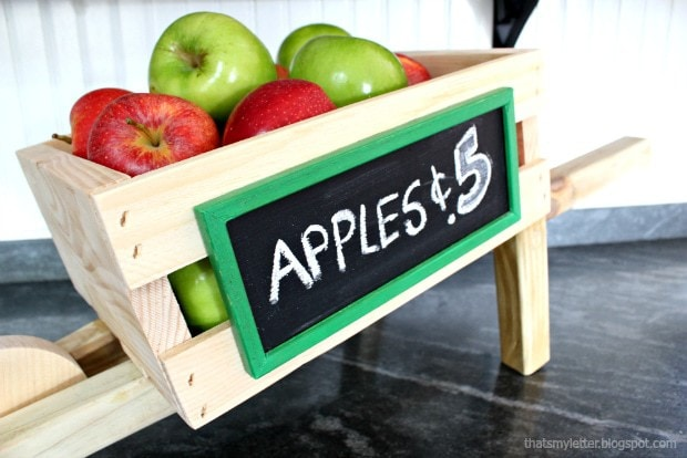tabletop rustic wheelbarrow with chalkboard sign