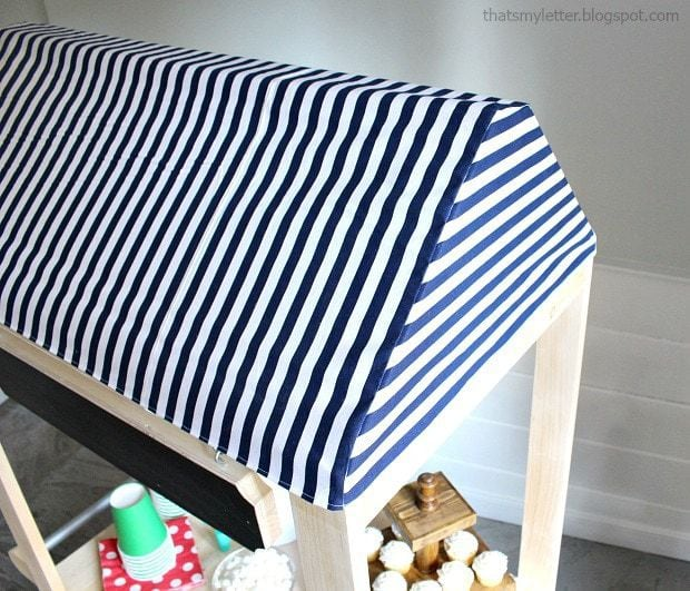 striped fabric awning on vendor cart