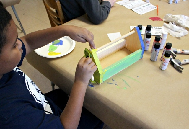 kids painting a toolbox