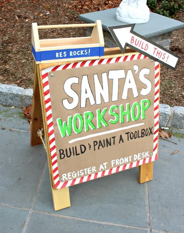 santa's workshop kids build and paint a toolbox