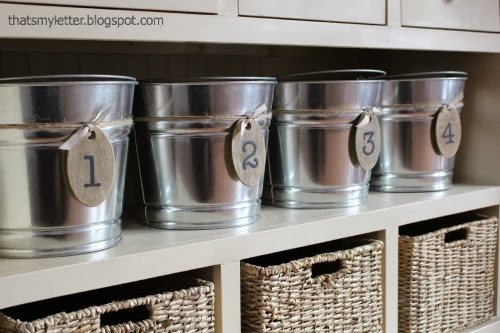 galvanized buckets in mudroom console