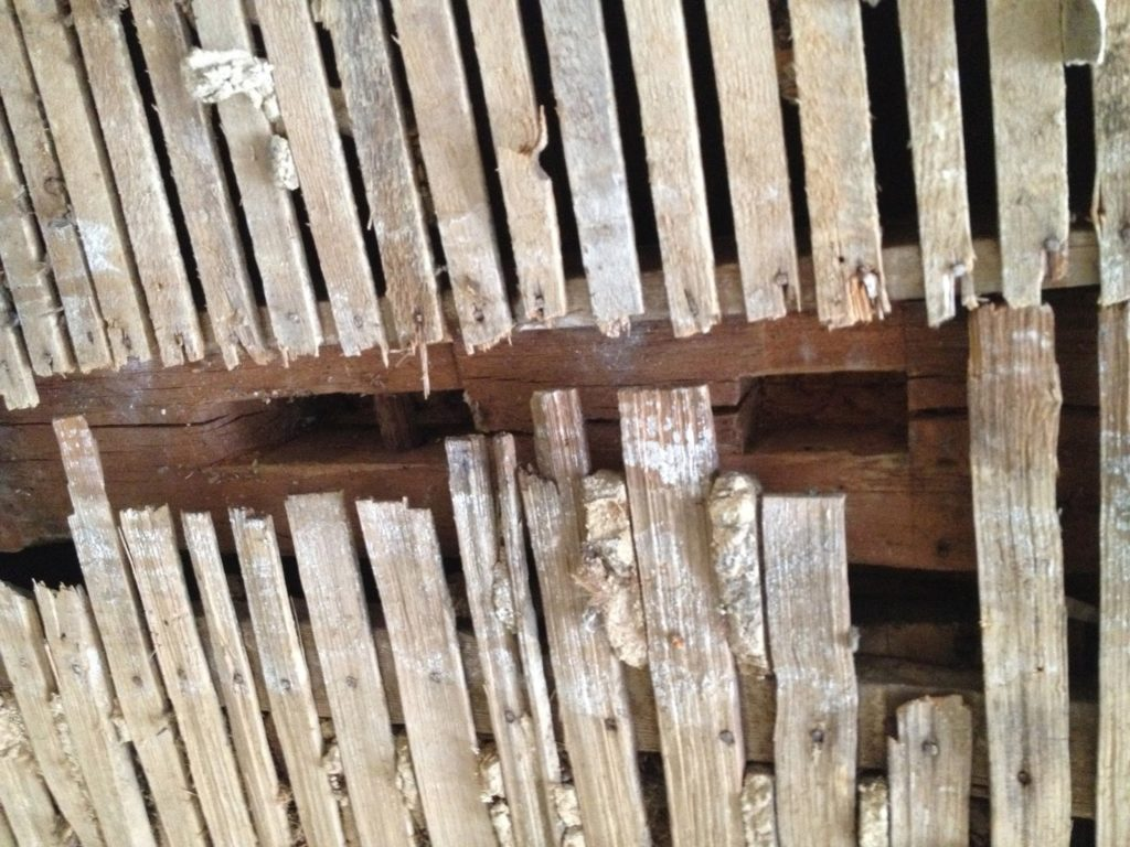 lath on ceiling covering original post and beam construction