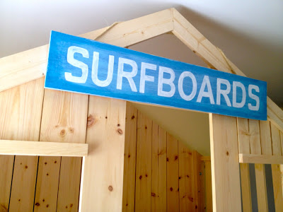 surfboards sign on loft bed