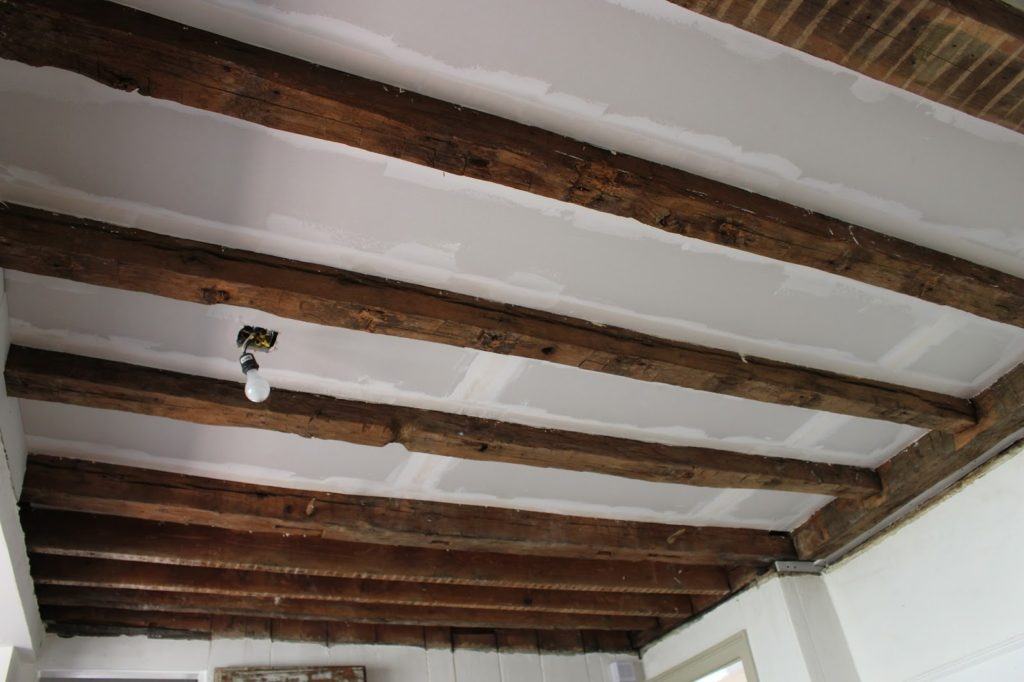 sheetrock between exposed wood beams