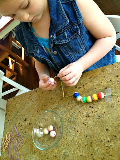 kids stringing wood beads