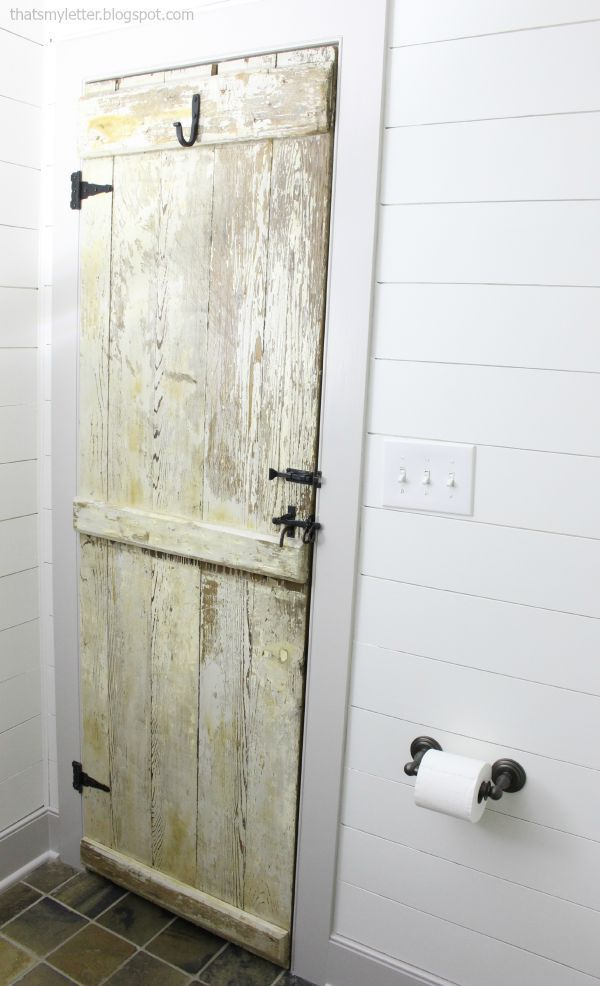 farmhouse style door in bathroom