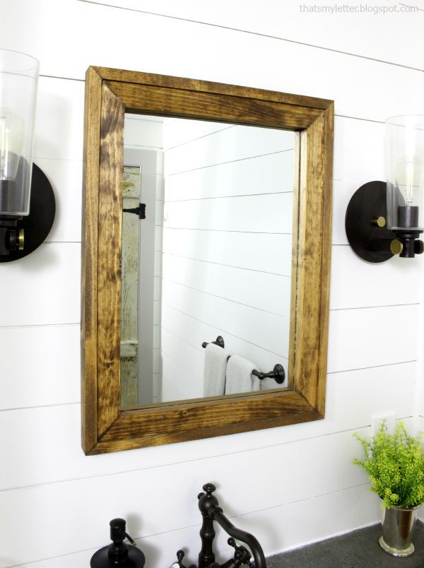 wood framed rectangular mirror