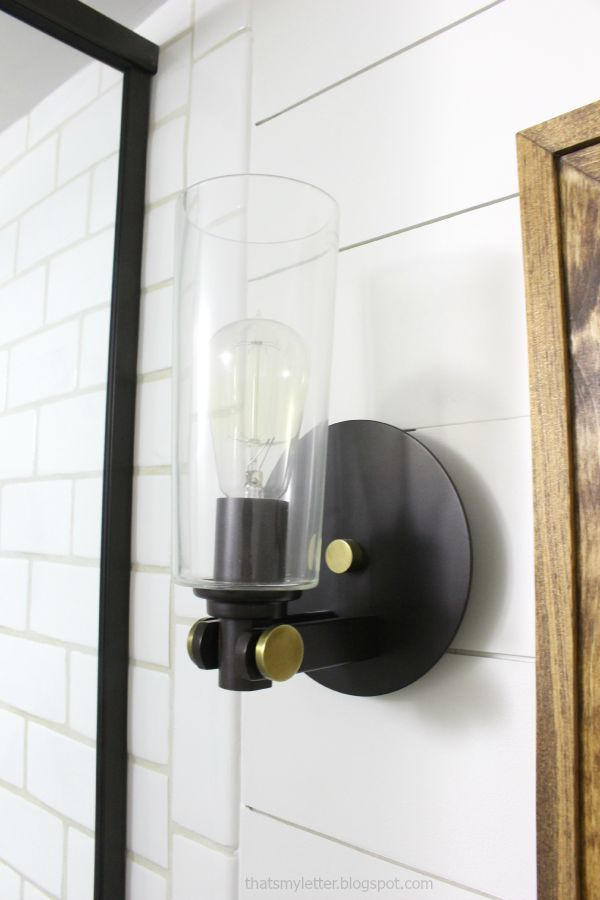 glass and metal circular sconces