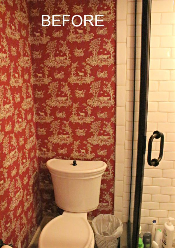 red toile wallpaper in bathroom