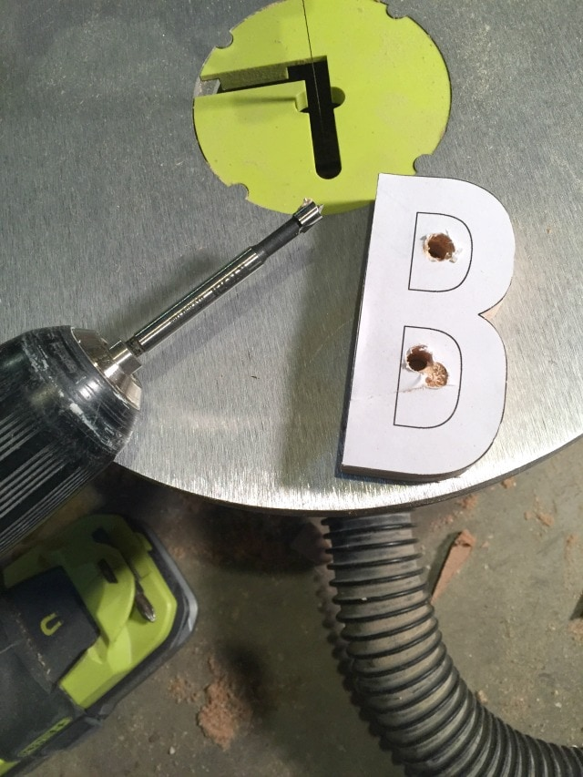 wood cut out letters on a scroll saw