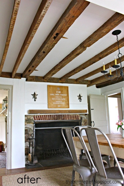 saltbox farmhouse dining room with original wood beam ceiling