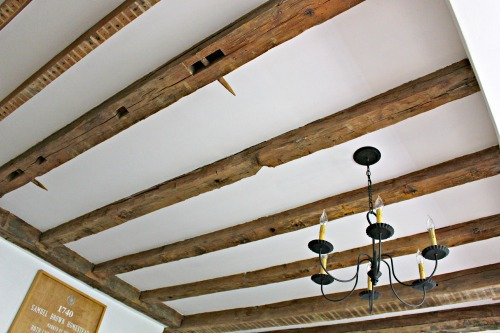 primitive antique home with exposed wood beam ceilings