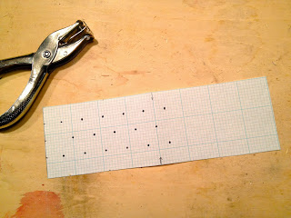 paper template with holes marked
