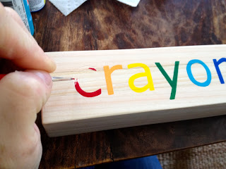 handpainted letters on wood