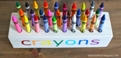 crayons in wood holder view from top