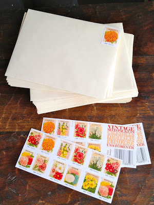 stamping envelopes with vintage seed packets