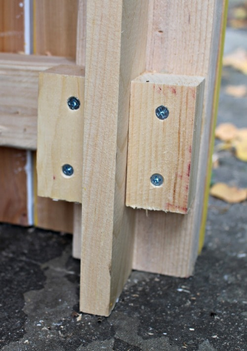 scrap wood to hold sign post in position
