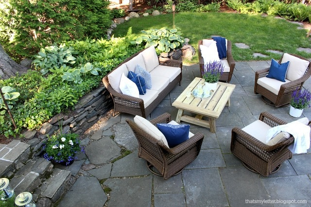 summer home tour patio area with koi pond filled in