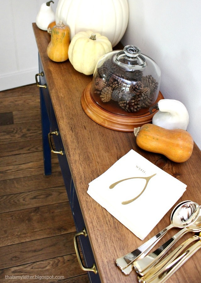 sideboard fall decor pinecones and gourds