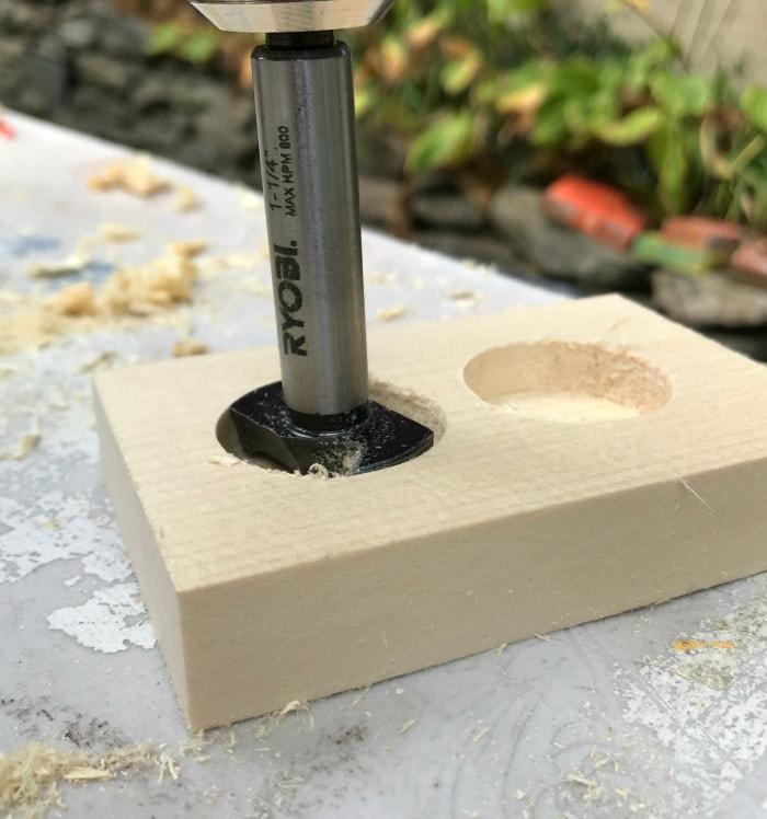 forstner bit into pine board