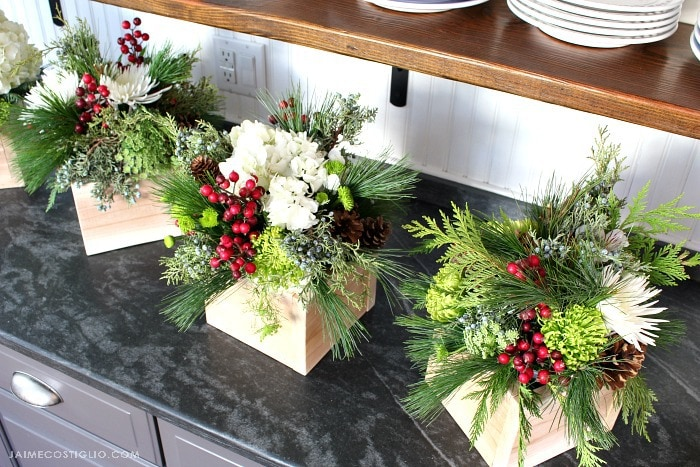 holiday floral arrangements in wood container