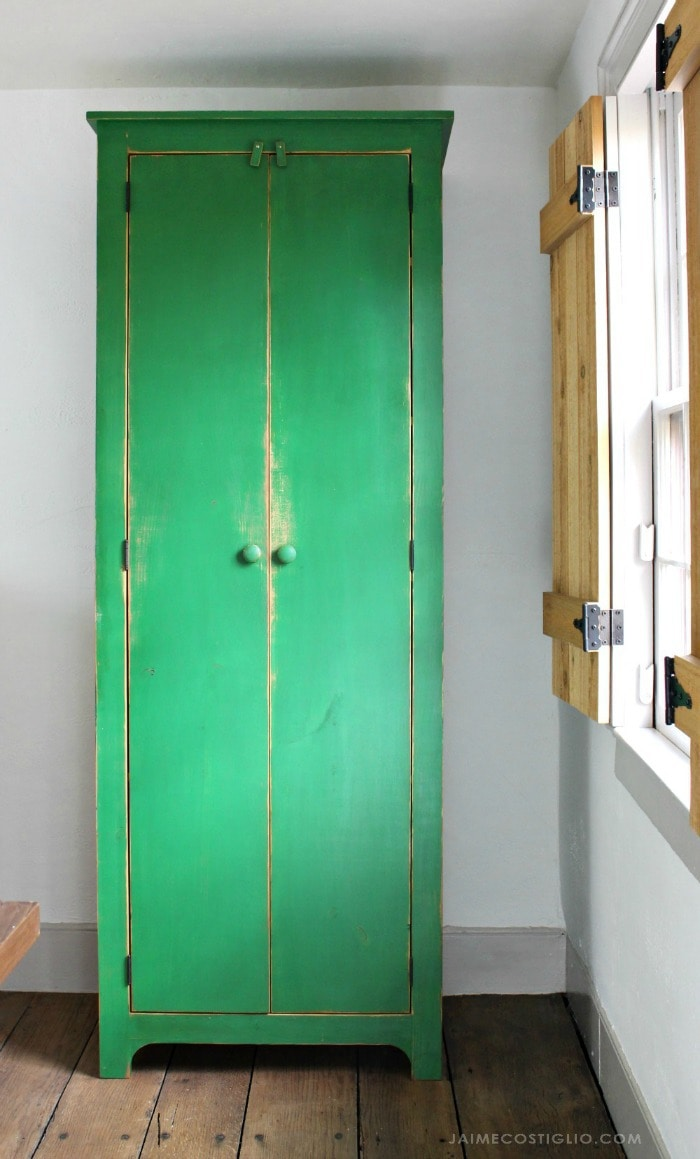 tall green storage cupboard