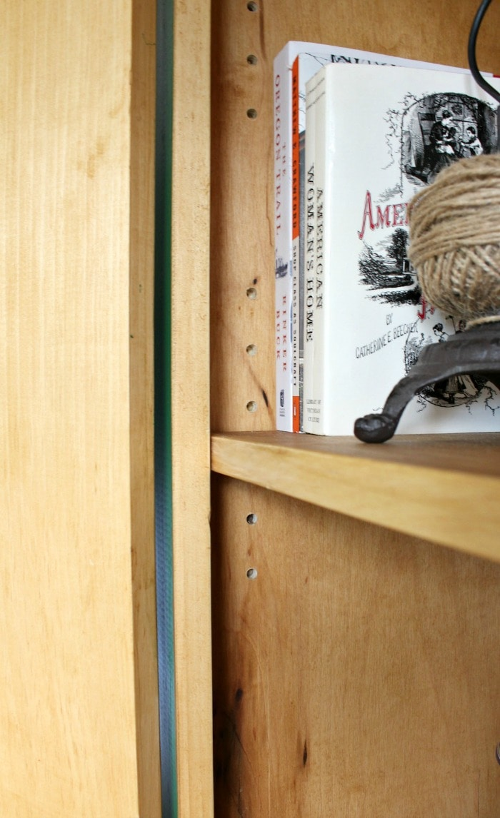 moveable shelf pin holes