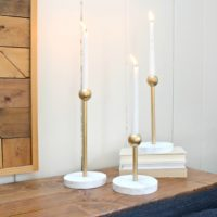 modern brass and marble candleholders feature