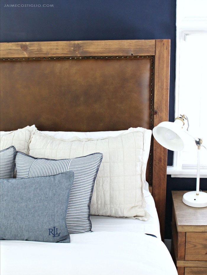 leather upholstered headboard with nailhead trim
